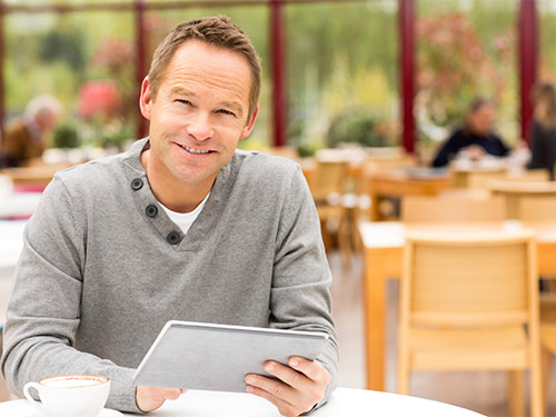 Man with Coffee and Tablet